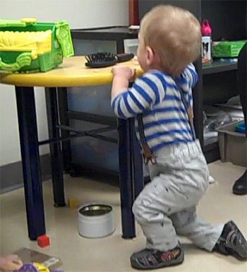 Baby holding table edge