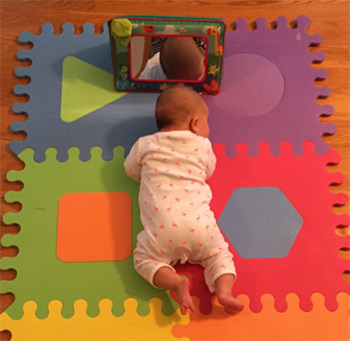 Tummy time on a mat