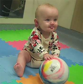 Baby on a mat with a ball