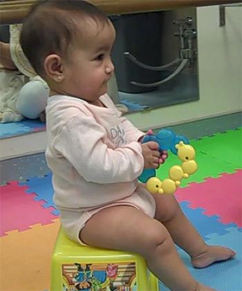 Baby sitting on a box